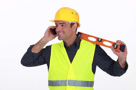 high visibility: Tradesman talking on the phone