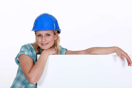 A female construction worker with a billboard  photo