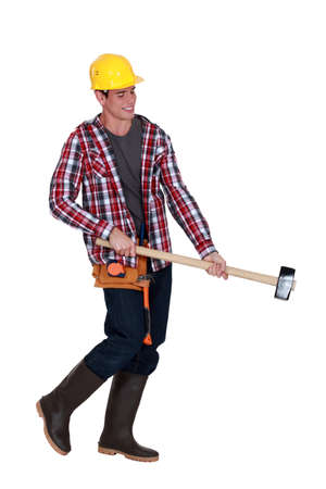 Man wielding sledge-hammer Stock Photo - 16546475