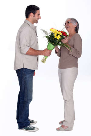 Son giving mother flowers Stock Photo - 16546986