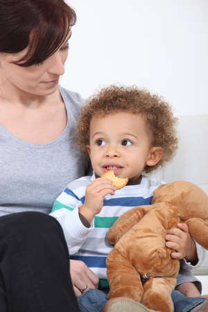 Woman and child with a teddy bear photo