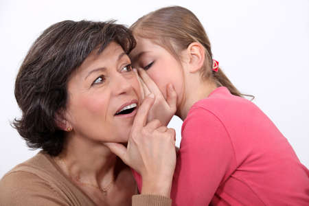 Telling her mother a secret  photo