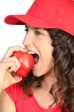 Brunette biting into apple Stock Photo - 16546642