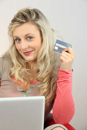 Portrait of a woman making online purchases photo