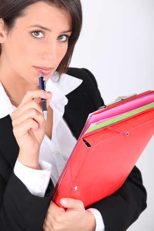 Woman with folders and pen