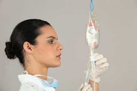 administer: Nurse with intravenous drip Stock Photo