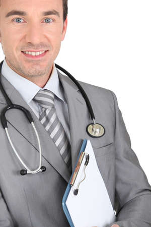 Young doctor with binder Stock Photo - 16546643