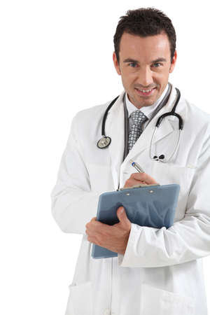 Doctor writing on clipboard smiling Stock Photo - 16546545
