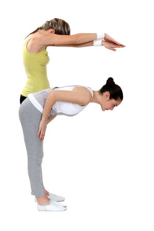 Two girls doing yoga Stock Photo - 16546474