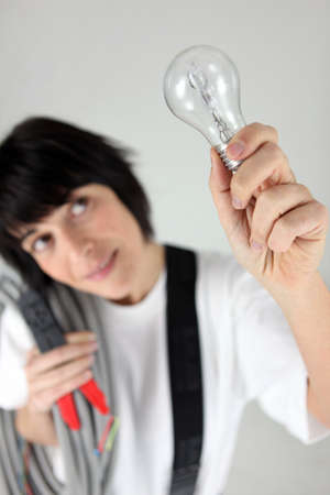 Electrician with a lightbulb photo