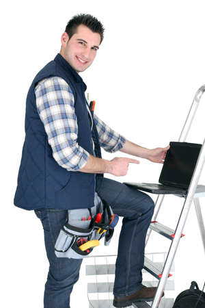 Electrician with a laptop Stock Photo - 16671060