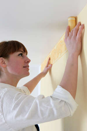 handywoman laying frieze in bedroom Stock Photo - 16670249
