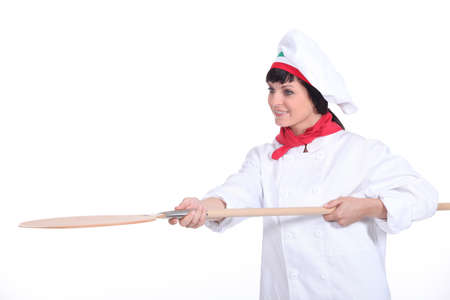 young woman pizza cook and a spade Stock Photo - 16670844