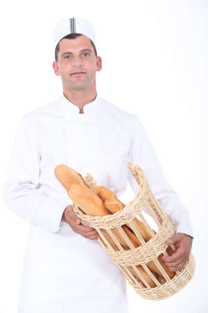 baker with basket of bread Stock Photo - 16670146