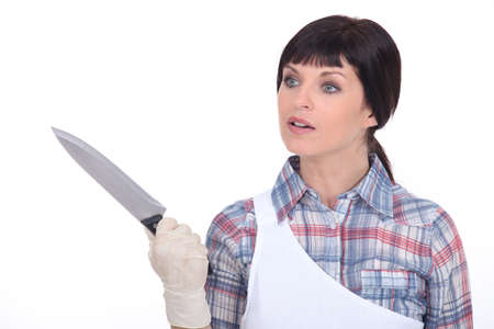 Woman with knife Stock Photo - 16670186