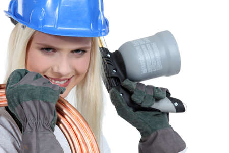 blowtorch: Blond woman with blowtorch and copper pipe Stock Photo