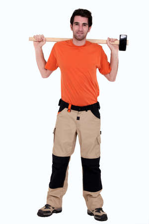full-length portrait of carpenter holding hammer at his back photo