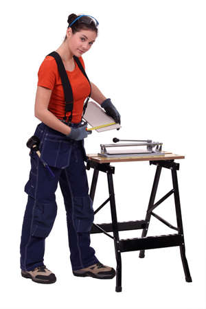 tiler: Woman with a tile cutter Stock Photo