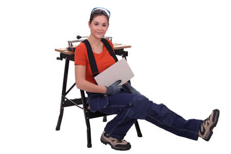 Woman cutting tiles Stock Photo - 16671028