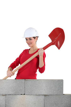 Woman mason holding a shovel Stock Photo - 16670500