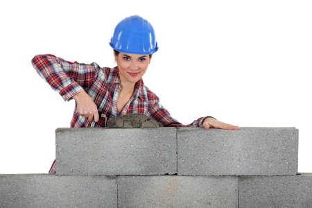 smoothen: Female bricklayer Stock Photo