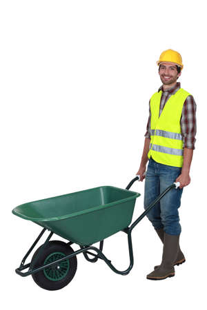 barrow: craftsman pushing a wheelbarrow