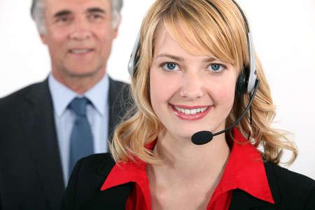 Smart woman wearing a telephone headset Stock Photo - 16669878