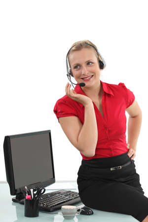Secretary wearing a headset Stock Photo - 16670763