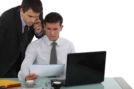 unclear: Perplexed business professionals Stock Photo