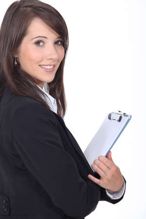 Young woman holding notepad photo