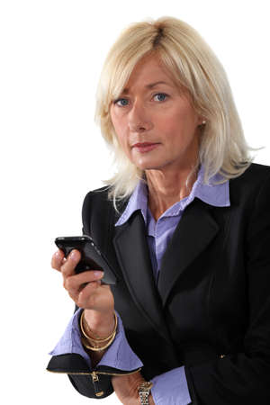 40 50: Middle-aged woman with cellphone Stock Photo