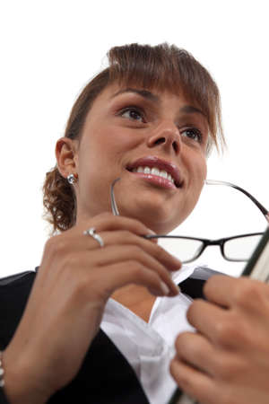 Businesswoman holding a pair of glasses photo