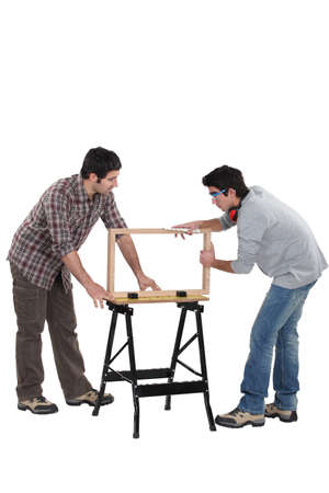 Carpenter and teenage helper Stock Photo - 16670743