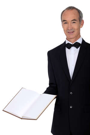 Middle-aged waiter holding menu photo
