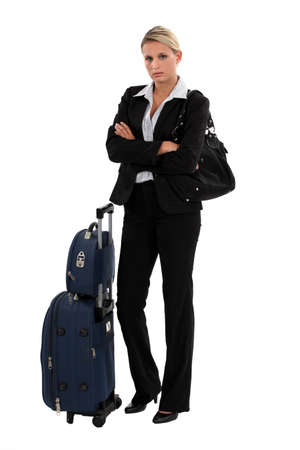 Blond businesswoman with luggage photo