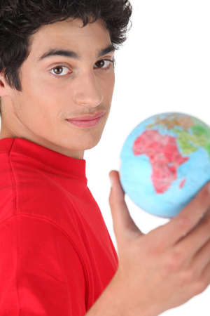 Young brunette with globe photo