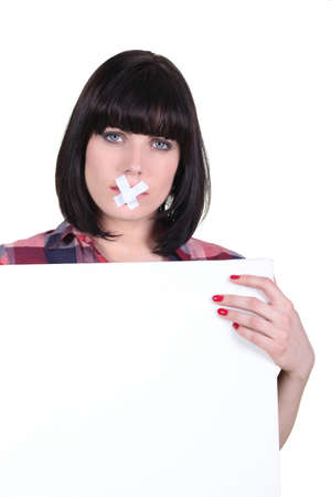 Talkative woman with her mouth sealed off Stock Photo - 16670680