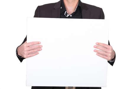 advertising board: man holding an empty advertising board
