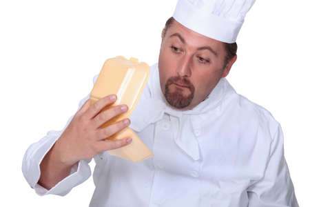 complaining: Chef looking at empty burger box Stock Photo