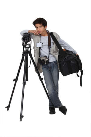 tripod: Little boy dressed as reporter Stock Photo