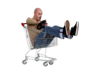 Man driving a shopping trolley photo