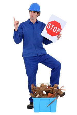Construction worker encouraging people to recycle Stock Photo - 16670689