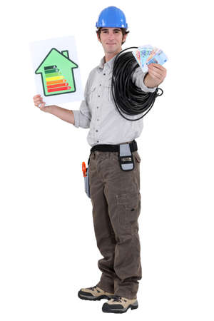 Laborer with wad of bills and energy rating sign photo
