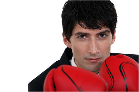 forceful: businessman wearing boxing gloves
