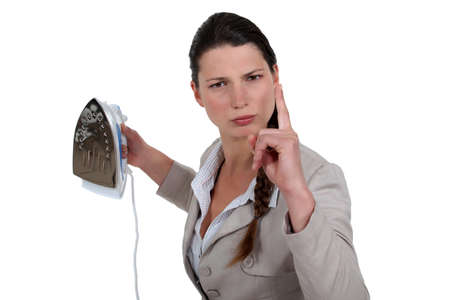 angry woman holding an iron photo
