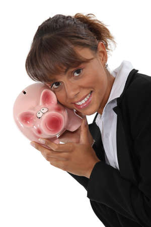 Businesswoman with a piggy bank photo
