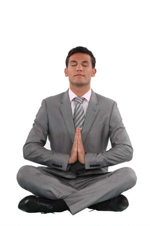 rest in peace: Businessman meditating Stock Photo