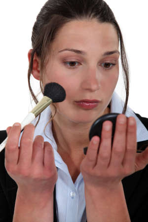 Woman applying blusher photo