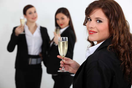 Suited women drinking champagne Stock Photo - 16670078