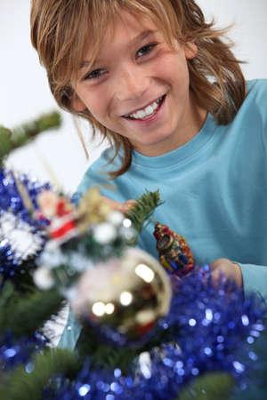Child decorating Christmas tree photo